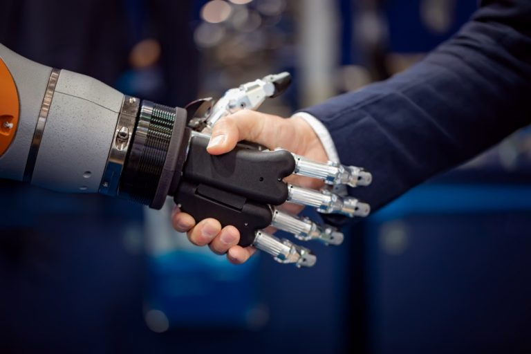 robot shaking hands with human